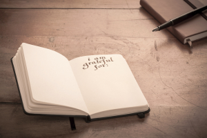 Notebook on Wooden Table - Gratitude Journal