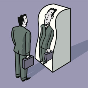 A businessman standing in front of a distorting mirror.